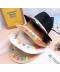 Dámský klobouk s barevnými dekoracemi