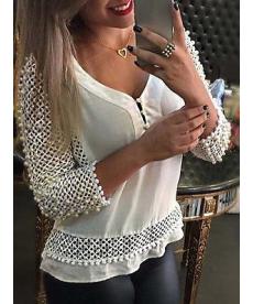 Zdobený bílý top s dlouhými rukávy