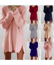 Dlouhý dámský svetr zdobený zipem