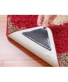 Set 4 ks protiskluzových silikonových rohů pod koberec