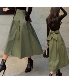 Dlouhá sukně s kapsami a velkou mašlí
